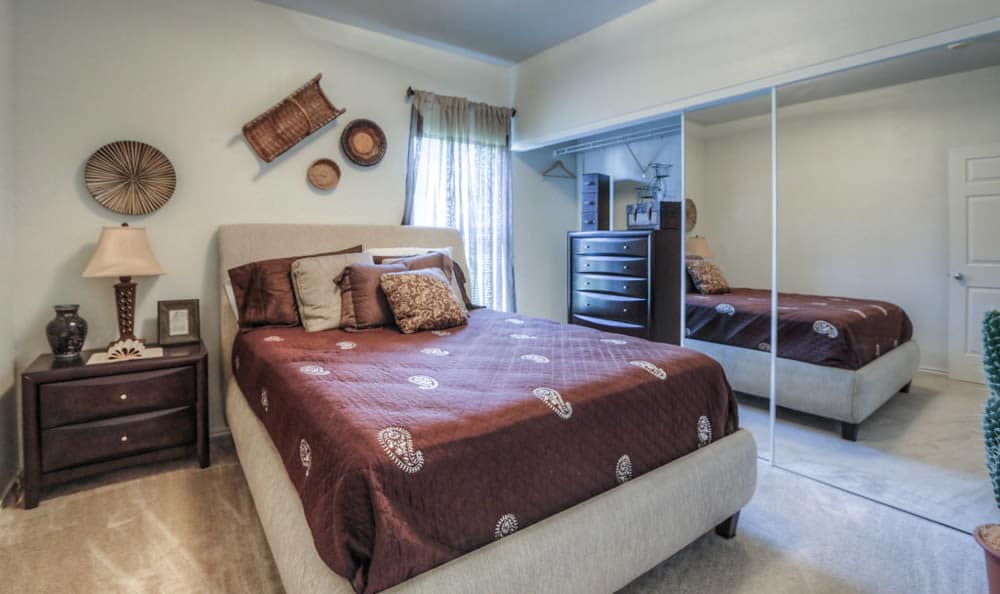 Well decorated bedroom at Stone Creek Apartments