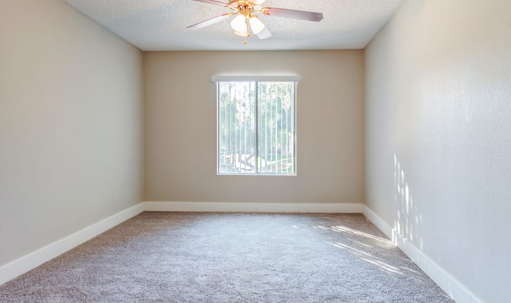 Ceiling fan and plush carpet in bedroom at Elliot's Crossing Apartment Homes in Tempe