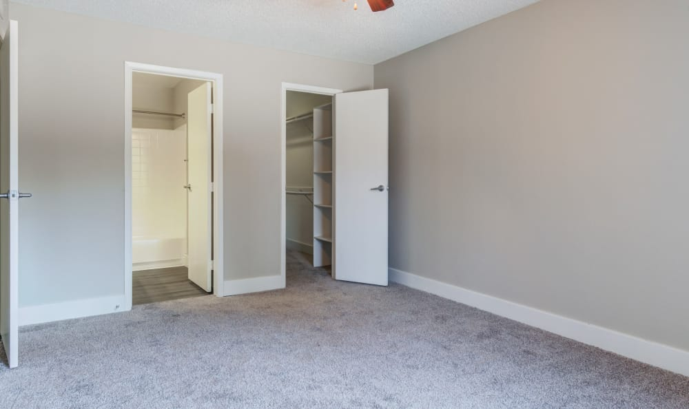 Spacious master bedroom in model home at Elliot's Crossing Apartment Homes in Tempe