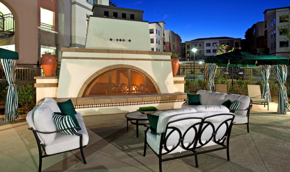 Comfortable seating in front of an outdoor fire place at Mountain Gate & Mountain Trails