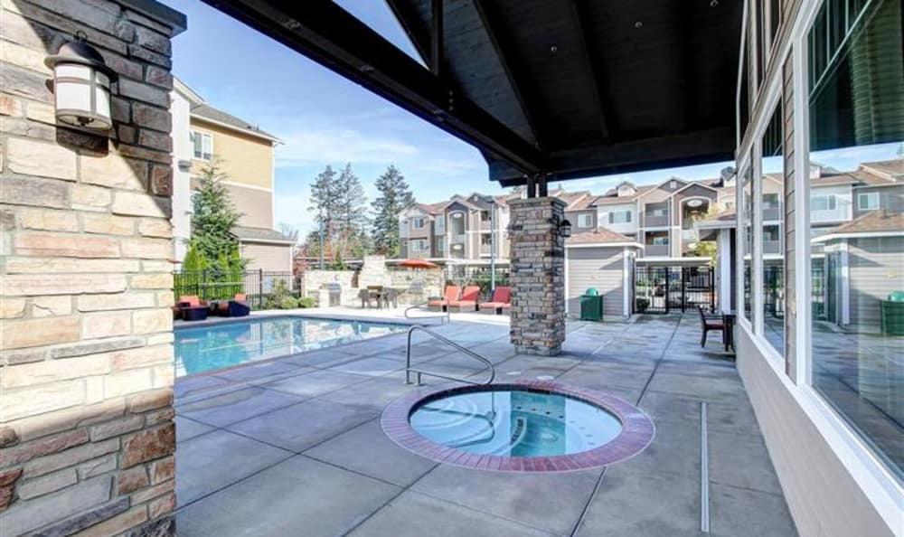 View of the hot tub near the pool area at Woodland Apartments in Olympia, WA