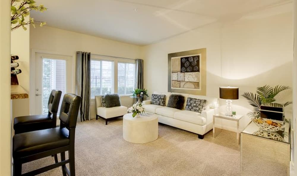 Open-concept living room in model home at Woodland Apartments in Olympia, WA