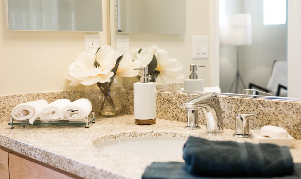 Granite countertops in bathroom of model home at IMT Townhomes at Magnolia Woods in Sherman Oaks, CA