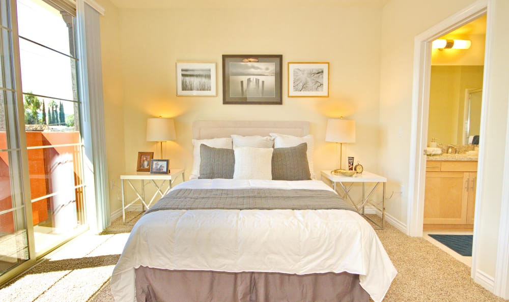 Well-decorated master bedroom with sliding door to private balcony in model home at IMT Townhomes at Magnolia Woods in Sherman Oaks, CA