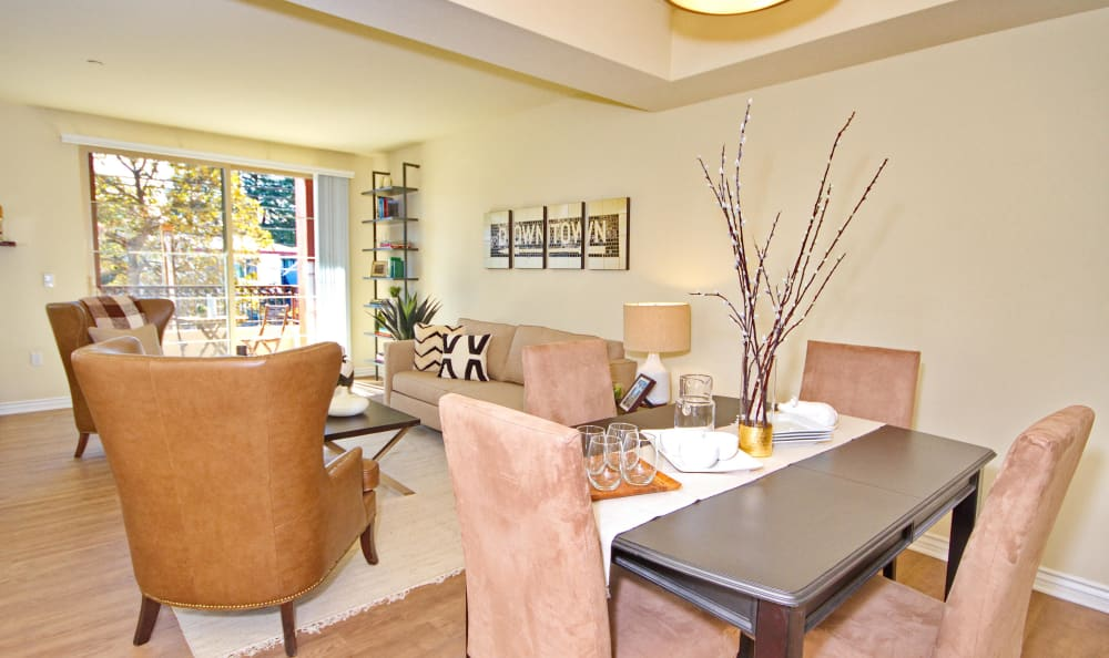 View of living room and private patio from dining area of model home at IMT Townhomes at Magnolia Woods in Sherman Oaks, CA