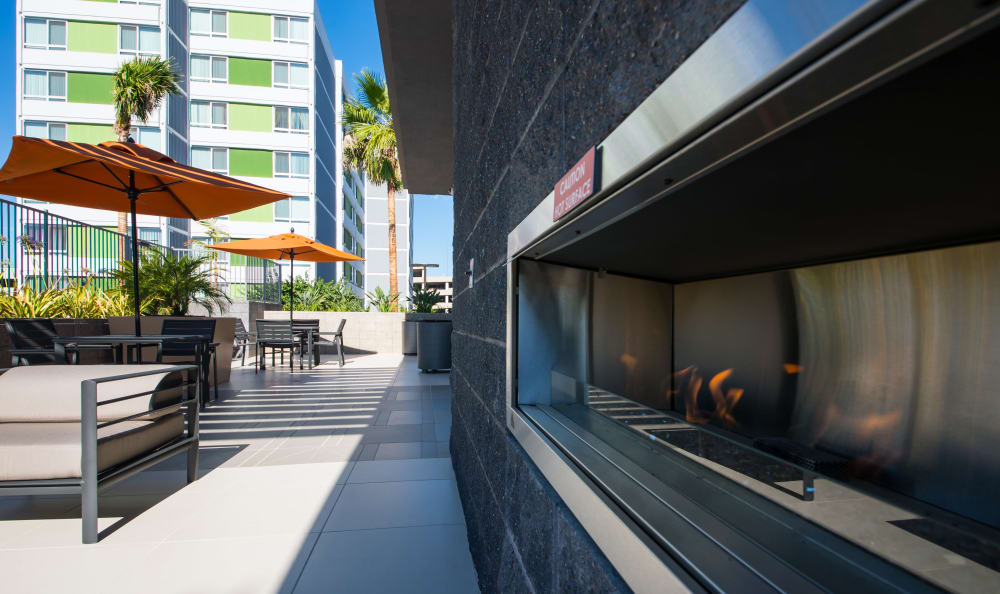 Outdoor fireplace and nearby seating at IMT Sherman Circle in Van Nuys, CA