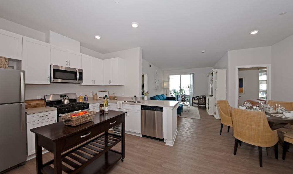 View of open-concept floor plan from kitchen of model home  at IMT Sherman Circle in Van Nuys, CA