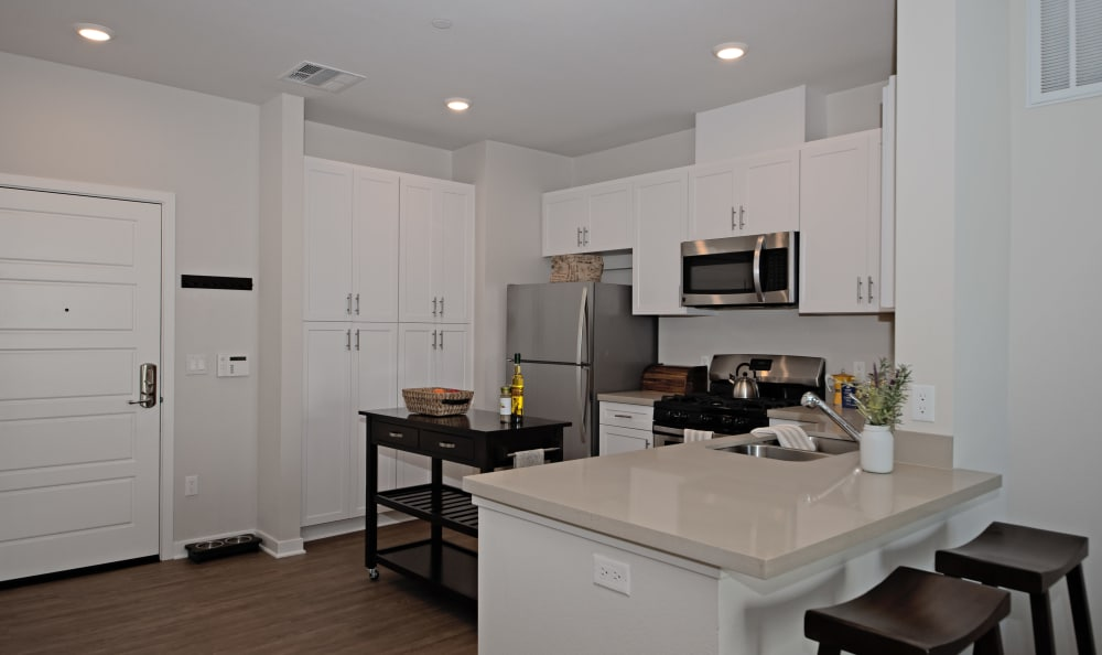 Modern, gourmet kitchen with granite countertops in model home at IMT Sherman Circle in Van Nuys, CA