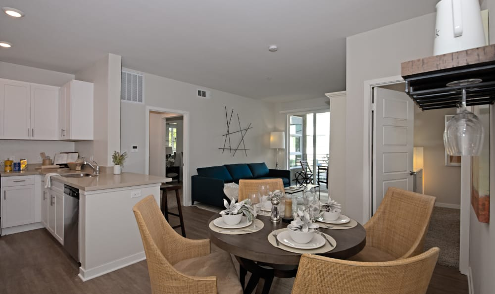 View of kitchen and main living space from dining area of model home at IMT Sherman Circle in Van Nuys, CA