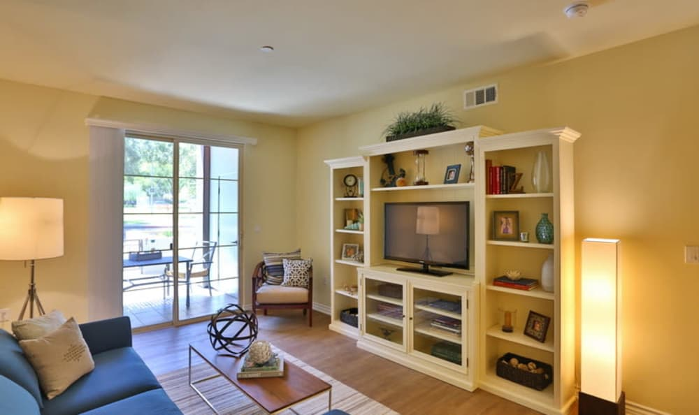 Bright and spacious living room looking out onto the private patio of a model home at IMT Park Encino in Encino, California