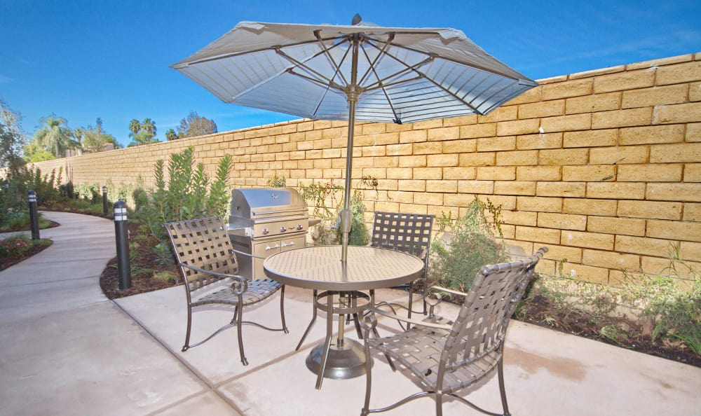 Shaded seating near resident barbecue area at IMT Townhomes at Magnolia Woods in Sherman Oaks, CA