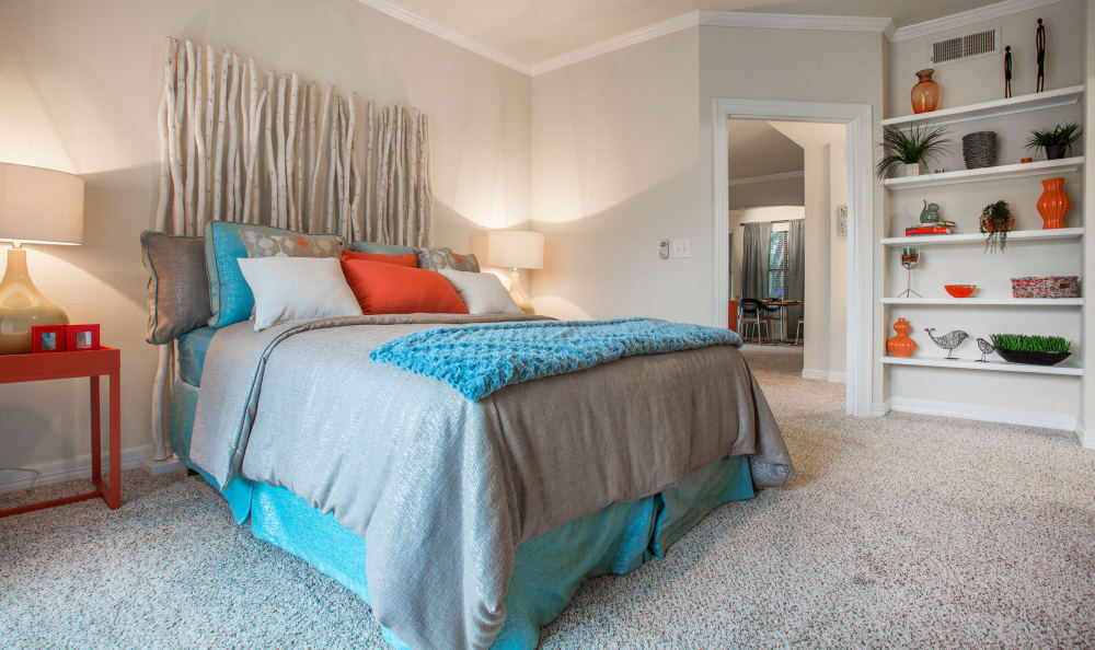 Well-decorated master bedroom with plenty of natural light in model home at Riata in Austin, TX