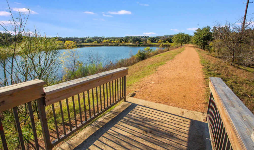View of jogging trail near lake at Riata in Austin, TX