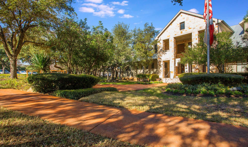 Exterior of leasing center and well-maintained landscaping at Riata in Austin, TX