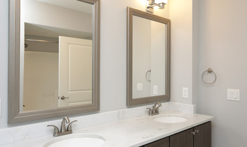 Spacious dual-sink bathroom in model home at Aqua on 25th in Virginia Beach, VA