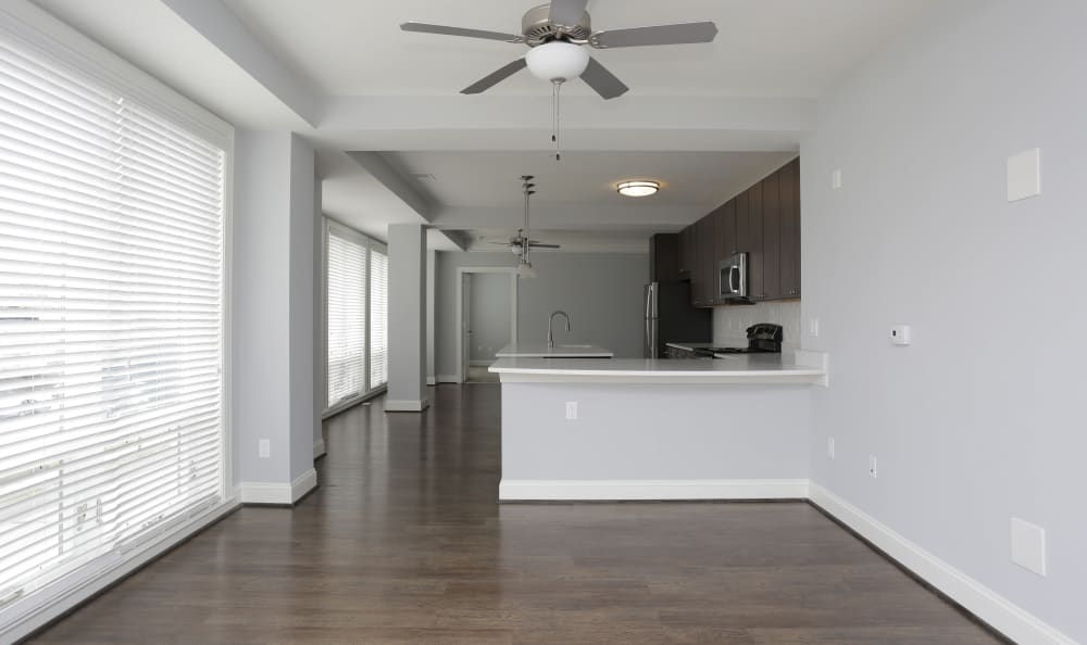 Ceiling fan and bay windows in model apartment home at Aqua on 25th in Virginia Beach, VA