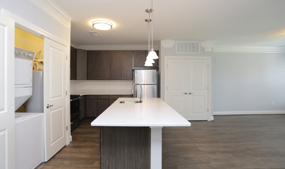 Spacious and open kitchen with custom lighting above the island in model home at Aqua on 25th in Virginia Beach, VA