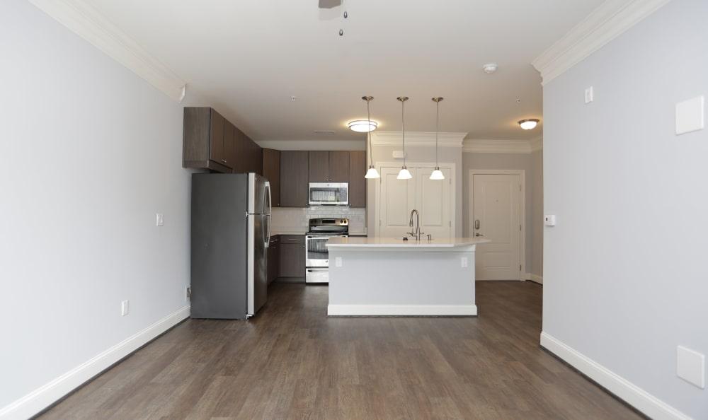Hardwood floors and custom bar lighting in the kitchen of model home at Aqua on 25th in Virginia Beach, VA
