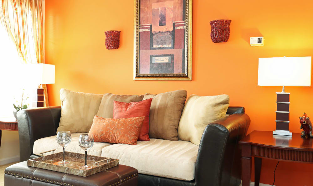 Bright living room in model apartment home at Woodbriar Apartments in Chesapeake, Virginia