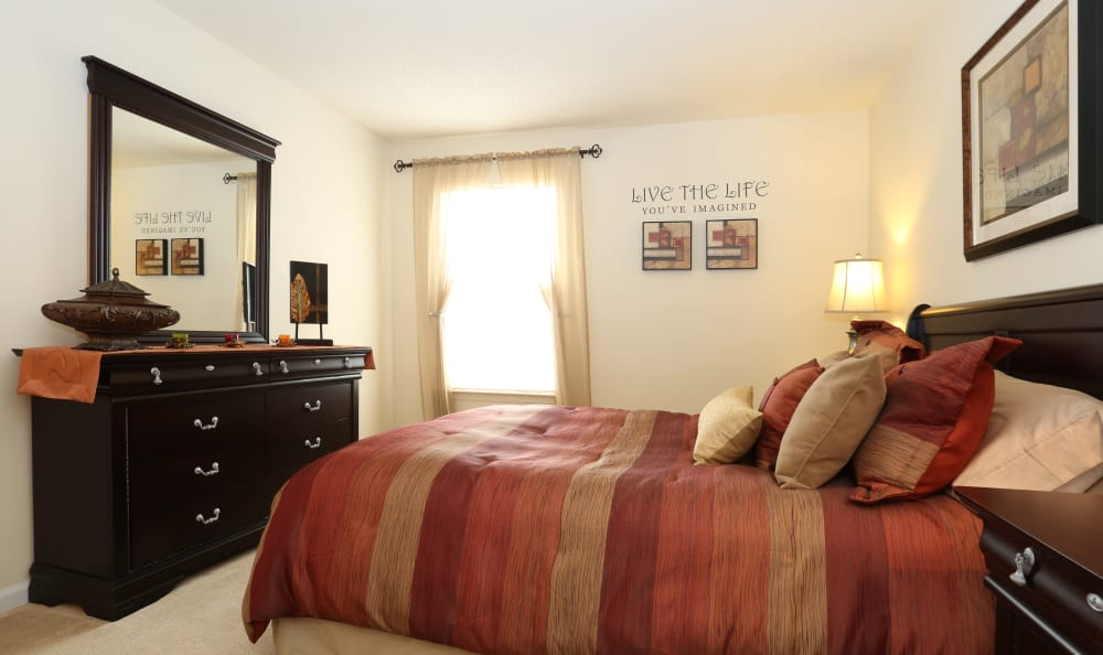 Bright and roomy master bedroom in model home at Woodbriar Apartments in Chesapeake, Virginia