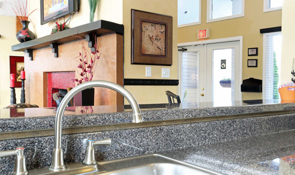 Kitchen with granite-style countertops in model apartment at Woodbriar Apartments in Chesapeake, Virginia