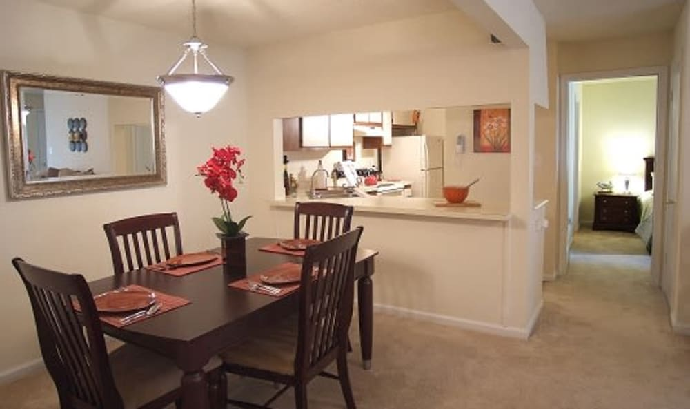 Dining area looking into kitchen of model home at Woodbriar Apartments in Chesapeake, Virginia