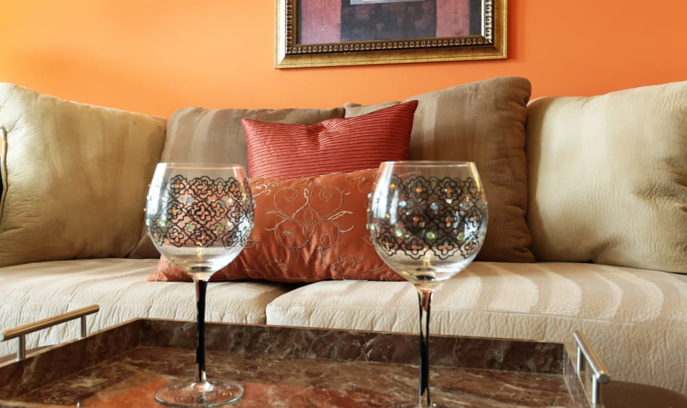 Couch and coffee table in well-decorated living room at Woodbriar Apartments in Chesapeake, Virginia