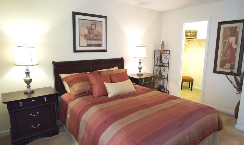 Master bedroom with ensuite bathroom in model home at Woodbriar Apartments in Chesapeake, Virginia