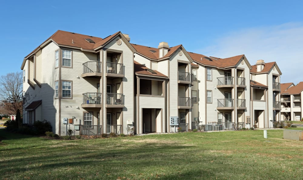 Resident building exterior at Woodbriar Apartments in Chesapeake, Virginia