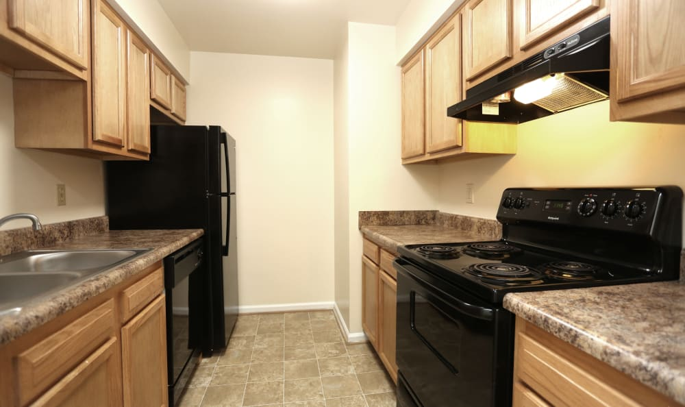 Kitchen in model home at Willow Oaks Apartments in Chesapeake, Virginia
