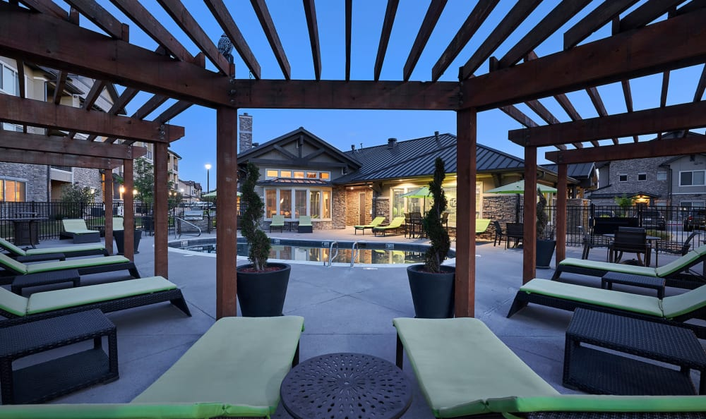 Pool Deck lounge area at sunset at M2 Apartments in Denver, CO