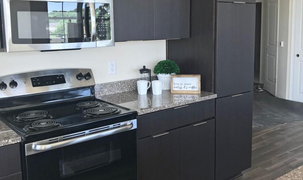 Enjoy our modern apartments kitchen at Nexus Luxury Apartments in Virginia Beach, Virginia