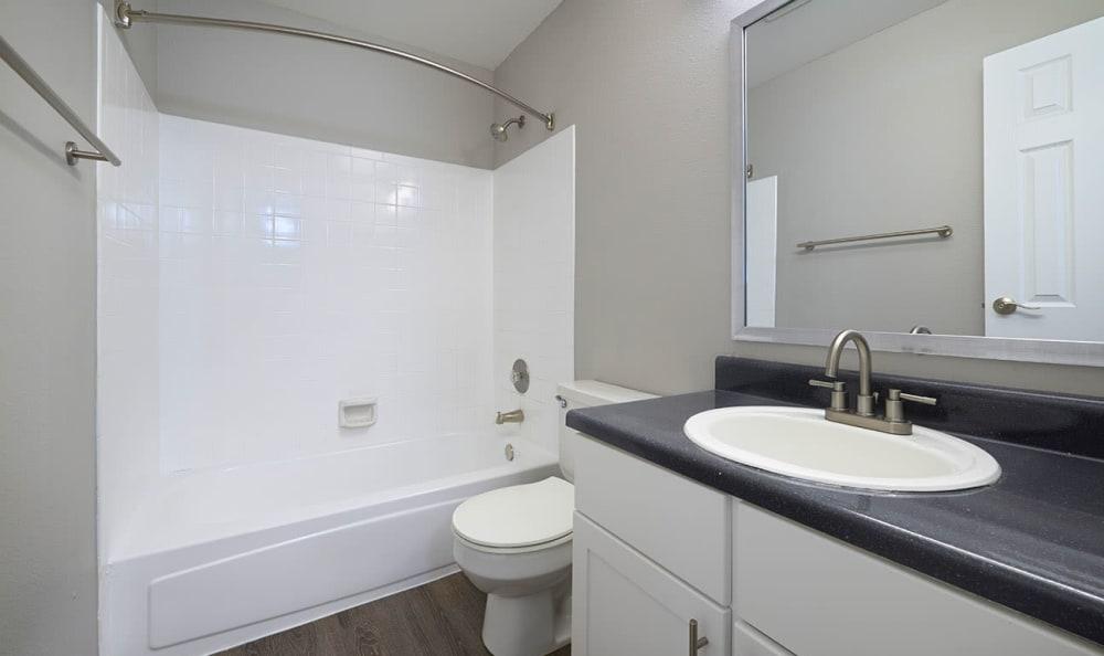 White bathroom renovation Bennington Apartments easy!