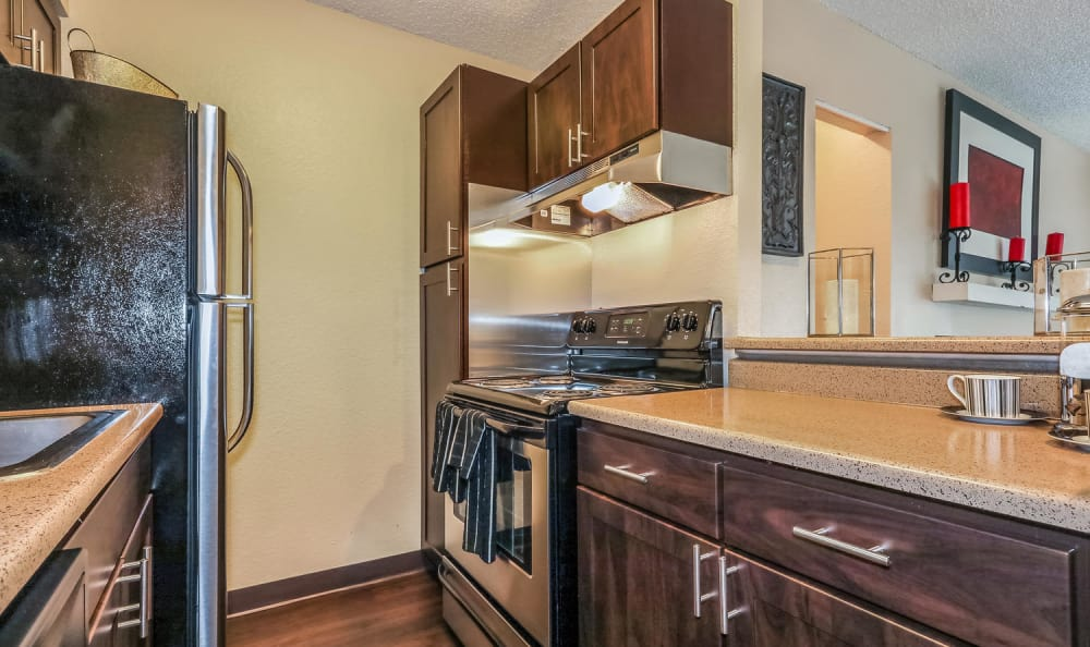 Galley kitchen at City Center Station Apartments in Aurora, Colorado