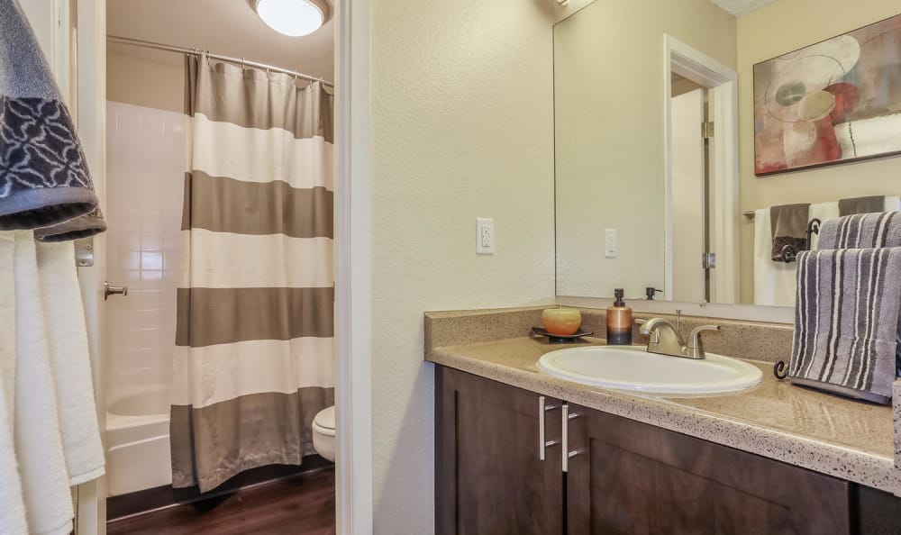 Well lit model bathroom at City Center Station Apartments in Aurora, Colorado