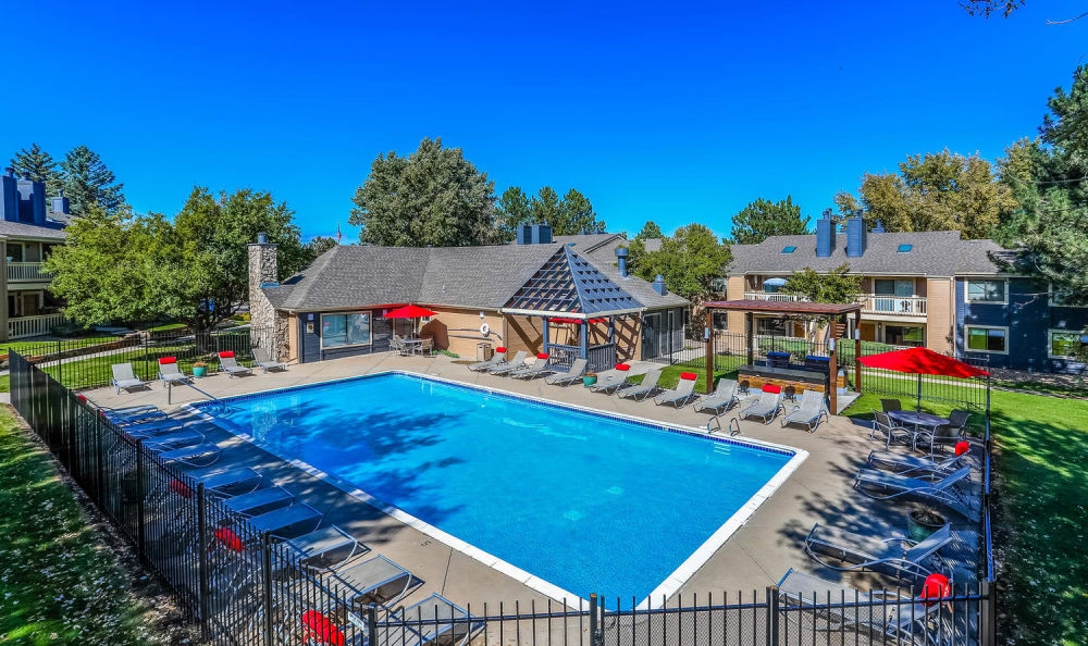 Swimming pool and seating at City Center Station Apartments in Aurora, Colorado