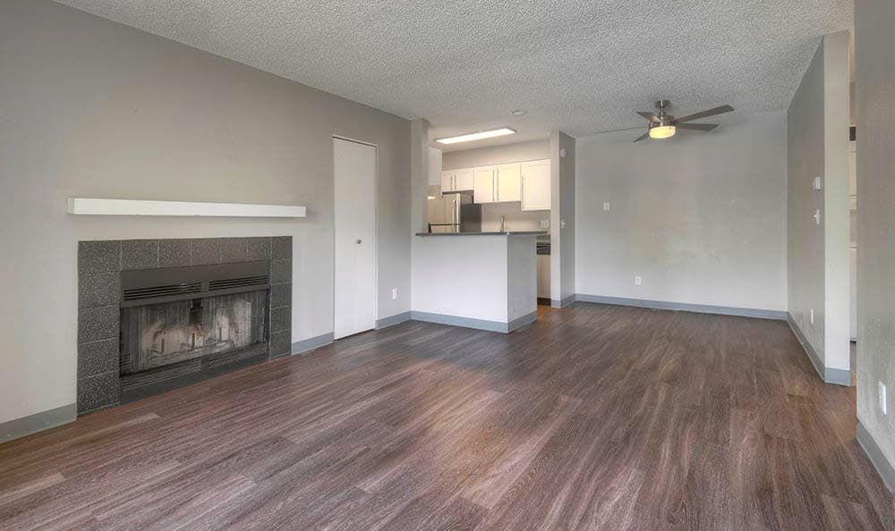 Living room model with hardwood floors at City Center Station Apartments in Aurora, Colorado
