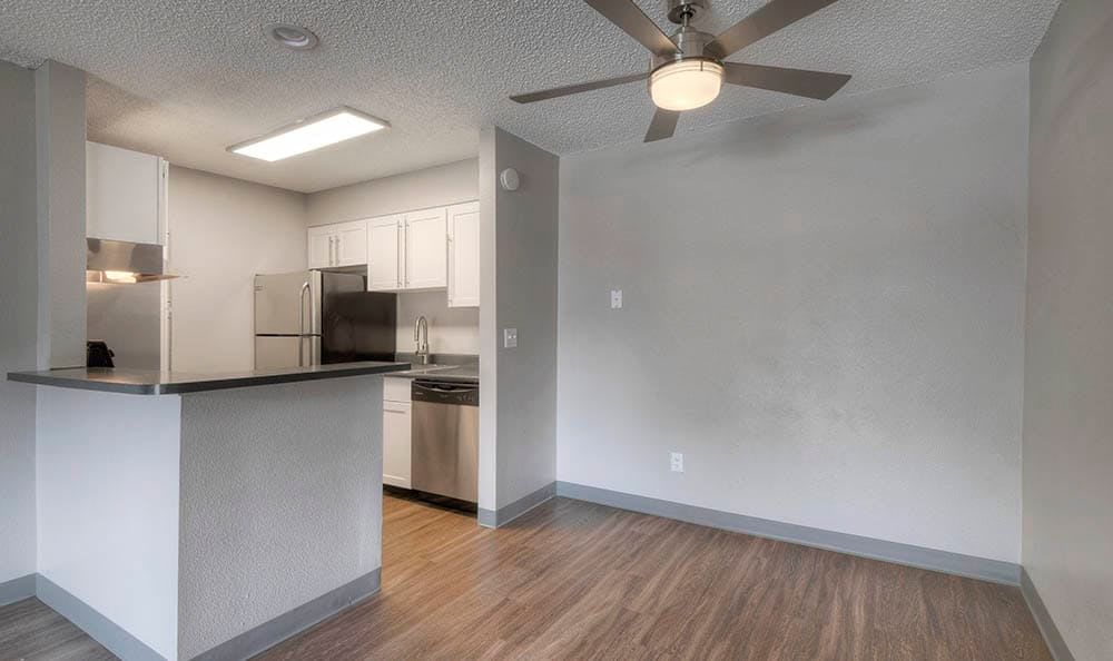Connected kitchen and dining room at City Center Station Apartments in Aurora, Colorado