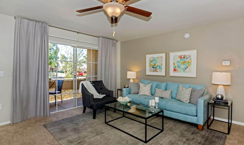 Modern decor and ceiling fan in living room of model home at The Boulevard in Phoenix, Arizona