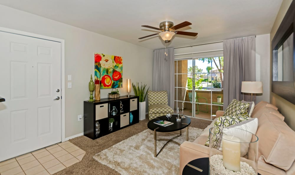 Spacious living room with ceiling fan in model home at The Boulevard in Phoenix, Arizona