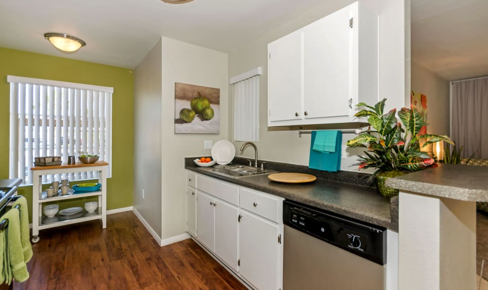 White cabinetry and hardwood floors in model home at The Boulevard in Phoenix, Arizona