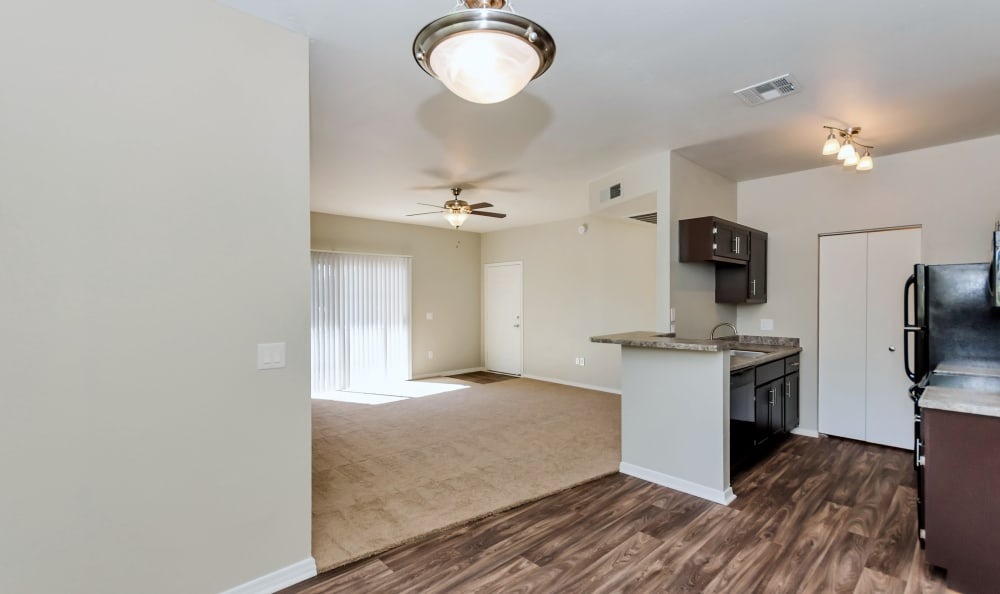 Living area with hardwood floors in kitchen of model home at The Boulevard in Phoenix, Arizona