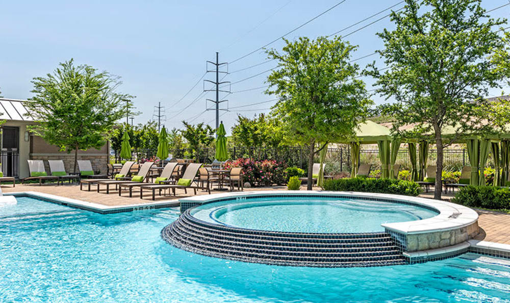 Our apartments in Richardson, Texas showcase a luxury swimming pool