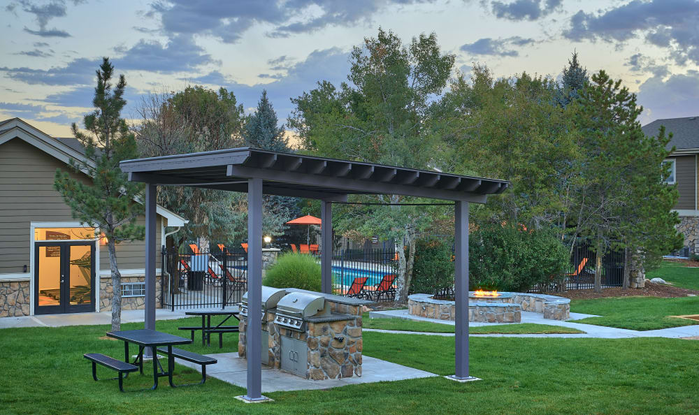 covered BBQ Area at sunset at Crossroads at City Center Apartments in Aurora, CO