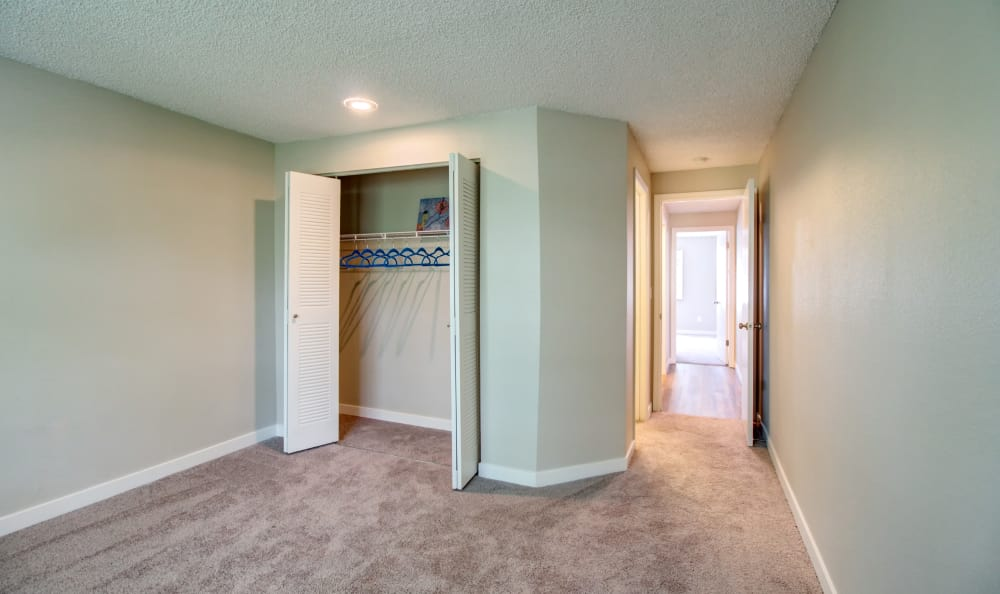 Large master bedroom in model home at Discovery Landing Apartment Homes in Burien, WA