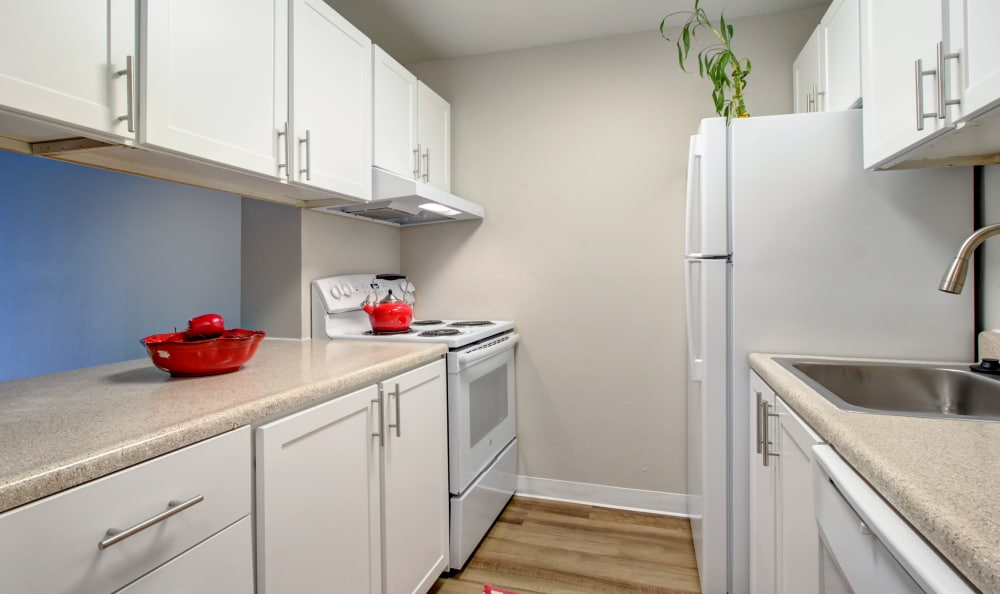 Modern kitchen in model home at The Boulevard at South Station Apartment Homes in Tukwila, Washington
