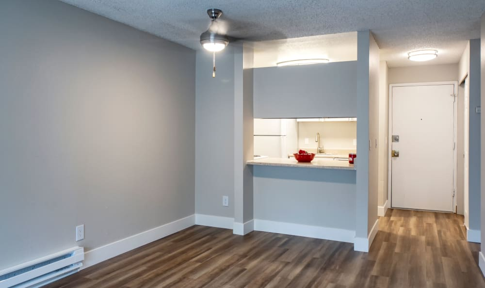 Hardwood floors in model home at The Boulevard at South Station Apartment Homes in Tukwila, Washington