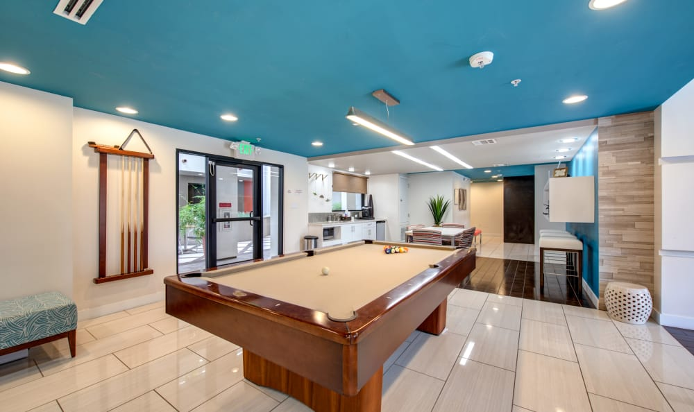 Pool table and recreation room at IMT Park Encino in Encino, CA