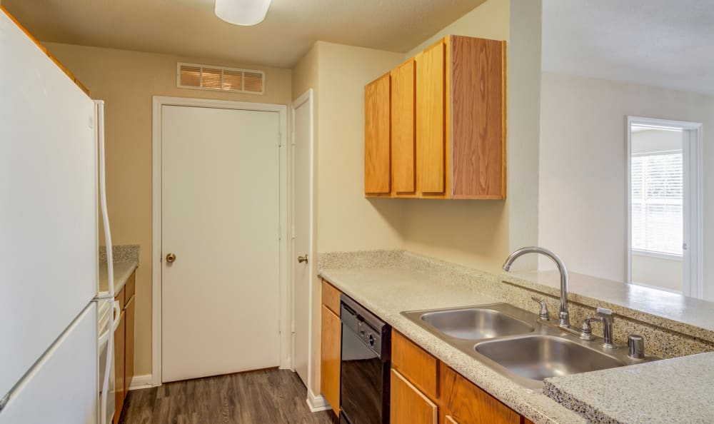 Laundry room in select units at Kenwood Club at the Park in Katy, TX