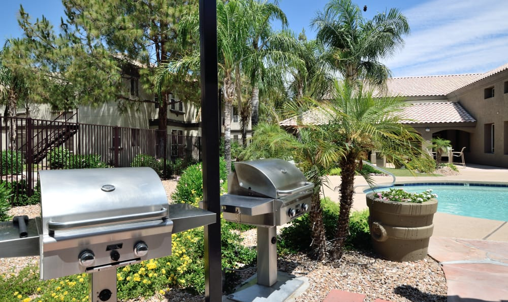 Barbecue area with gas grills near the pool at Lumiere Chandler in Chandler, Arizona